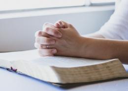 Woman with bible seeking God's revelation