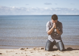 Man praying on a beach about God's will